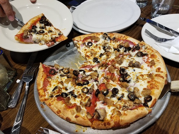 Romio's Special: Canadian Bacon, Italian Sausage, Pepperoni, Mushrooms, Black Olives