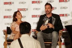 Amy Jo Johnson & Jason David Frank receive an original vintage Power Rangers toy from the late 90s