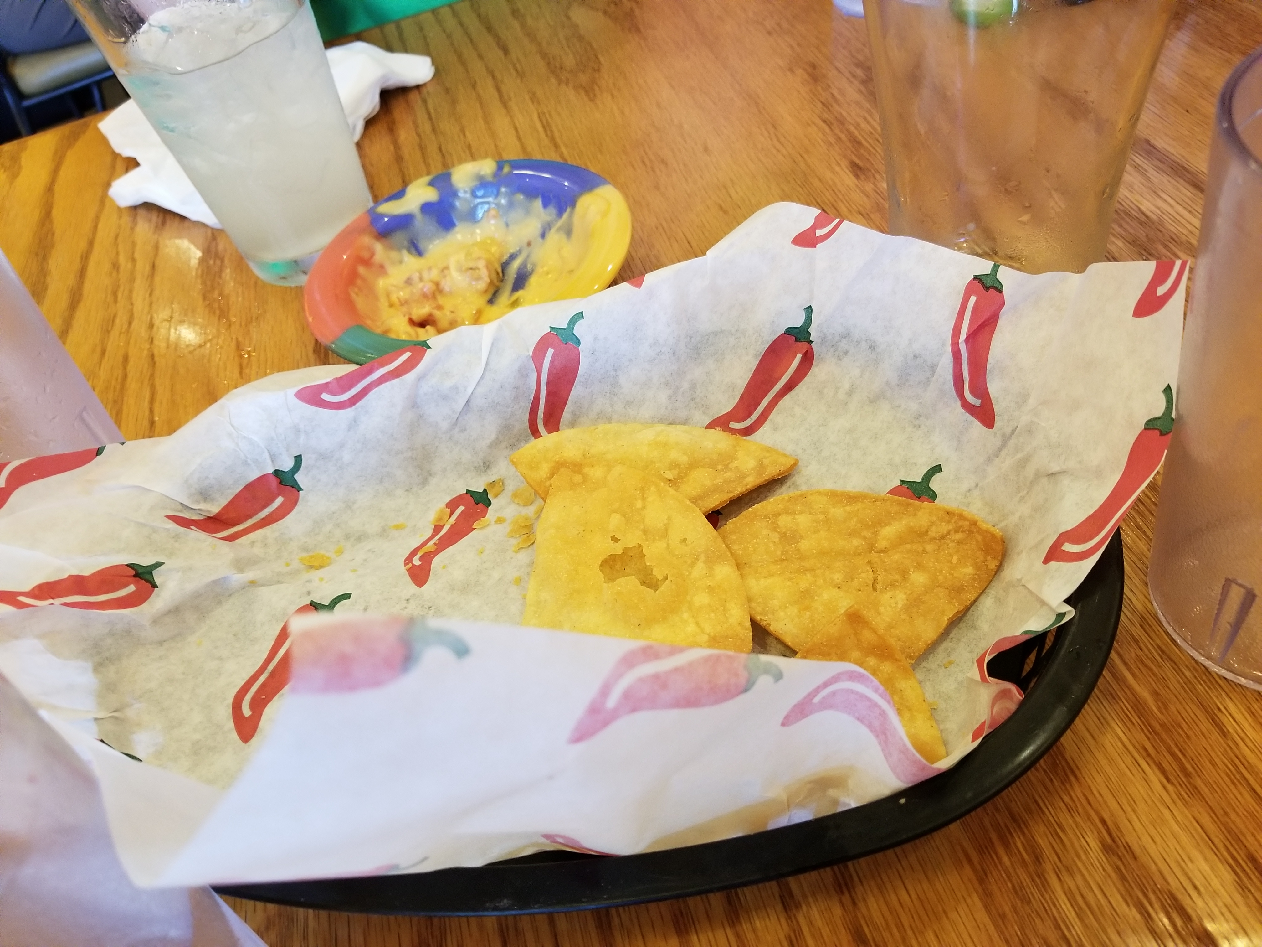The demolished house-made tortilla chips with queso